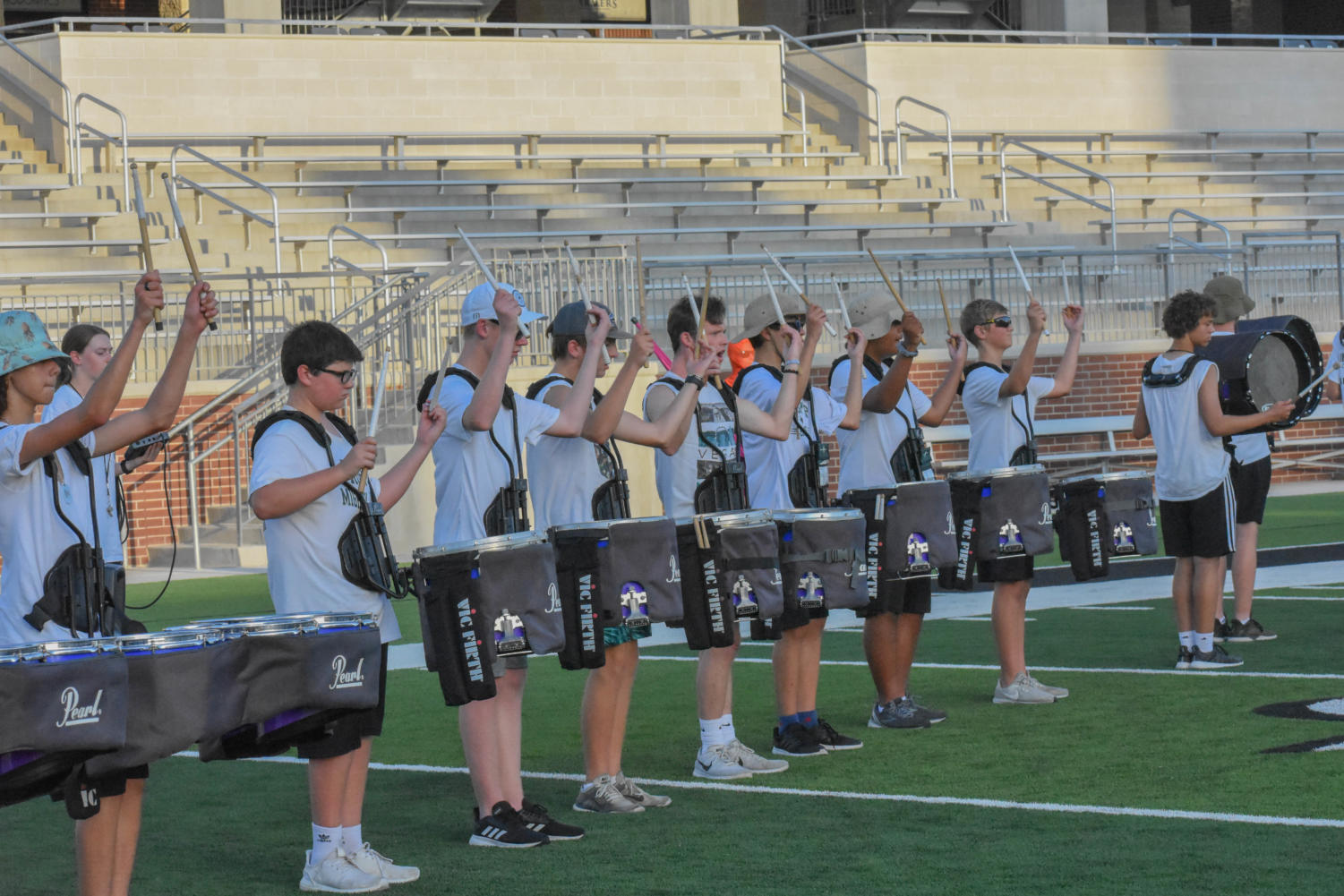 Drumline practices their drum solo Tuesday, Aug. 20. The team performs at pep rallies, band competitions and football games. They will perform during halftime at the first home game of the season, Aug. 30.