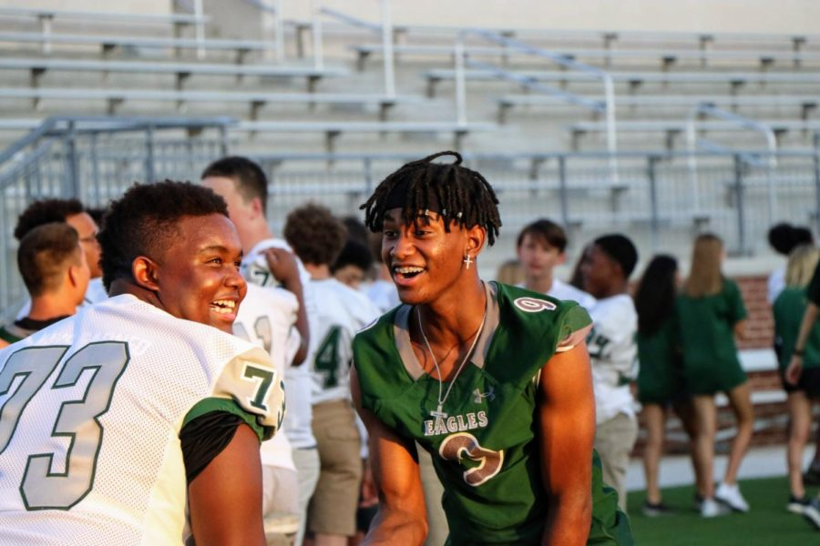 3, Cameron Johnson and 73, Wenallis Thomas   prepare to walk across the field at Meet The Eagles. The event took place at the newly opened $48-million stadium. Children's Health has naming rights for 10 years.