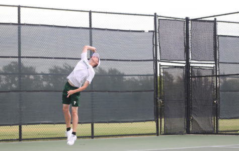 Tennis team serves up first win in districts