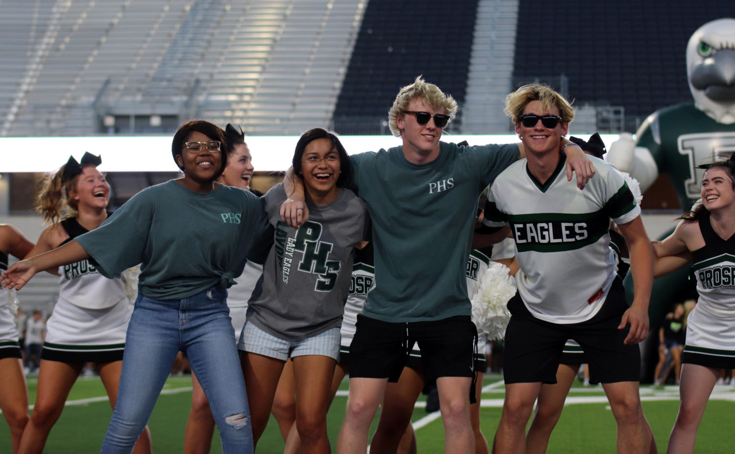 Senior+spirit+leaders+Ifunanya+Nwaoba%2C+Alyssa+Gonzalez%2C+Sam+Covert+and+Collin+McDonald+perform+%22Hooked+on+a+Feeling%22+and+announce+it+as+the+senior+song.+After+all+the+athletes+were+introduced%2C+they+pumped+up+the+crowd+with+the+%27I+Believe+that+We+Can+Win%27+chant.+The+seniors+will+continue+to+boost+spirits+at+future+games+and+rallies.++