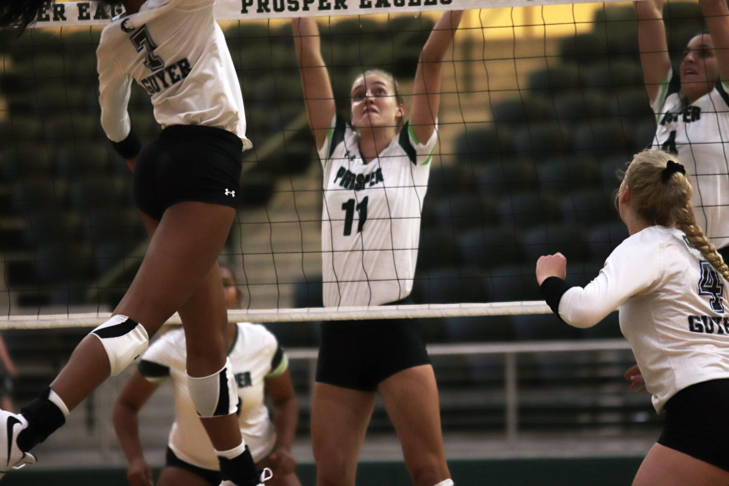 Shaylee+Shore%2C+No.+11%2C+prepares+to+block+a+shot+from+Denton+Guyer+in+the+volleyball+game+Aug.+16.+The+Lady+Eagles+currently+have+a+record+of+6-2+going+into+their+match+against+Rockwall+Heath+Aug.+22.+They+start+district+play+in+their+away+match+against+McKinney+High+School+Sep.+13.+