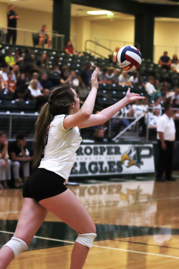 Nikki Steinheiser serves the ball during a game against Denton Guyer. They won the game with a record of 3-2 Friday night. They are currently ranked No. 11 in the nation.
