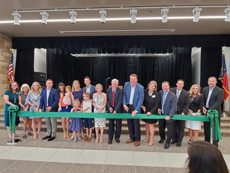 Chuck and Cindy Stuber, along with family and PISD administration, cut the ceremonial ribbon signifying the opening of Stuber Elementary.