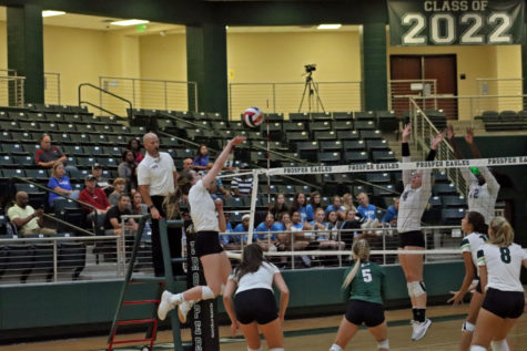 Nikki Steinheiser spikes the ball at the opposing team during the volleyball game Friday night in the arena. Prosper faced off against Denton Guyer and came out on top in a 5-set match. Volleyball season started Aug. 6 with their match against Waxahachie.