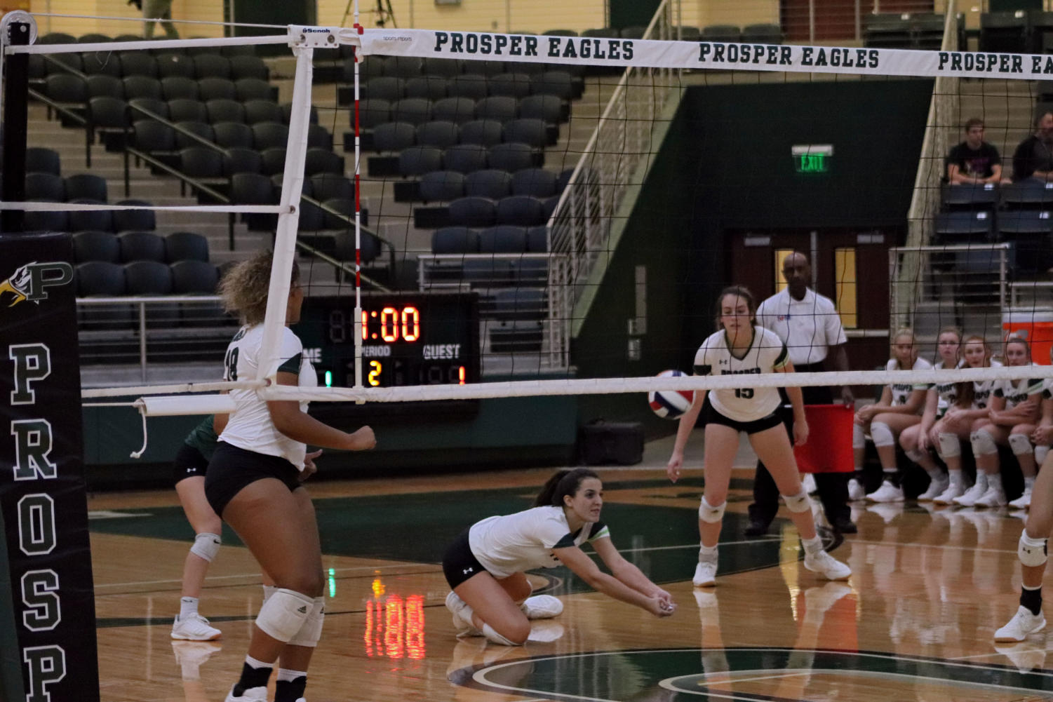 Samantha+Jacobs%2C+No.+4%2C+dives+for+a+ball+in+the+home+match+against+Denton+Guyer.+Jacobs+is+a+junior+and+in+her+third+year+on+the+varsity+volleyball+team.+She+recently+committed+to+the+University+of+Alabama+to+play+at+the+colligate+level.+