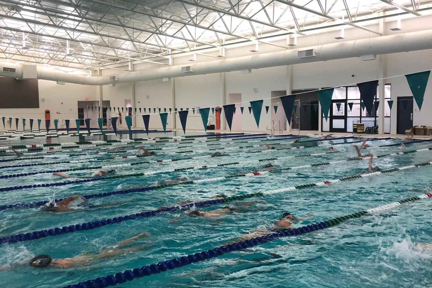 The Swim/Dive team enjoys their first year of practice in the newly opened Natatorium. The team has their first meet coming up on September 28. In preparation for the meet, the varsity team practices for two hours every morning, ready for the competition.