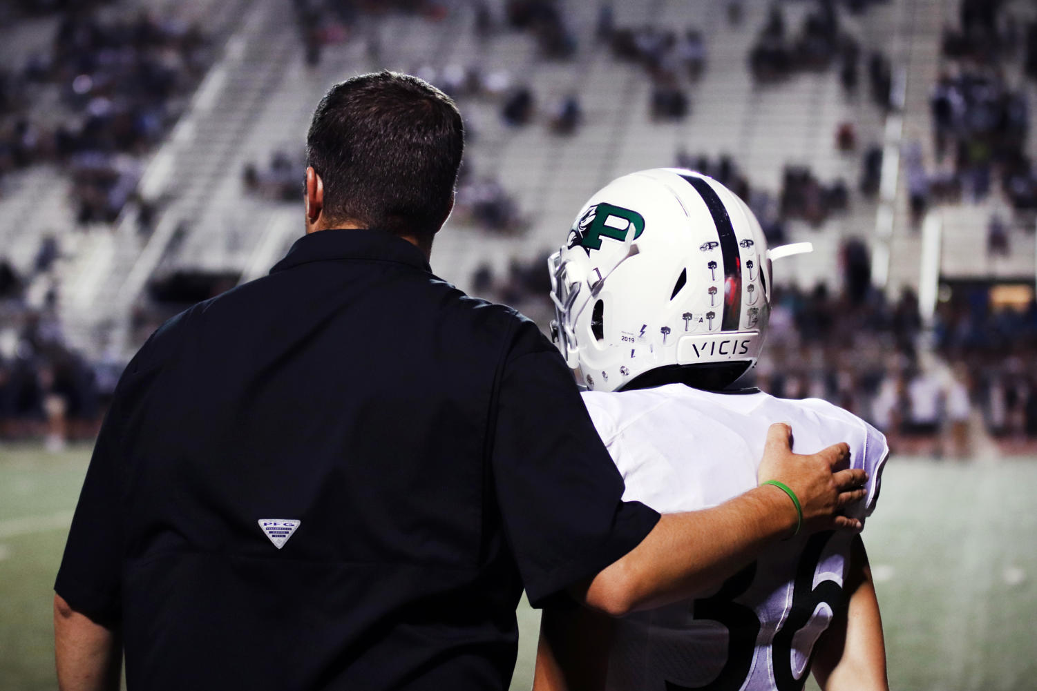 Coach Coby Richards and player Brad Larson  prepare for the junior kicker to enter the game Friday, Sept. 13. Prosper beat Flower Mound at their homecoming this evening after taking the lead of 57-34. Now, the Eagles have a record of 4-0 with a win over McKinney High on Friday.