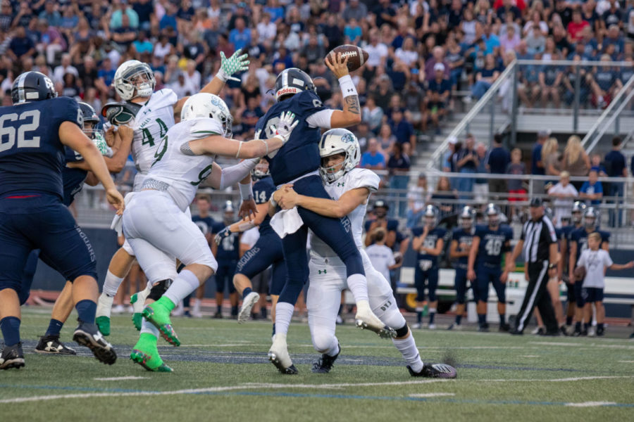 Tate Nichols, No. 15, tackles a Flower Mound player. The Eagles are 3-0 and will play their next game against McKinney High School Friday, Sept. 20 at the McKinney ISD Stadium. The McKinney Lions currently have a record of 2-1 this season.