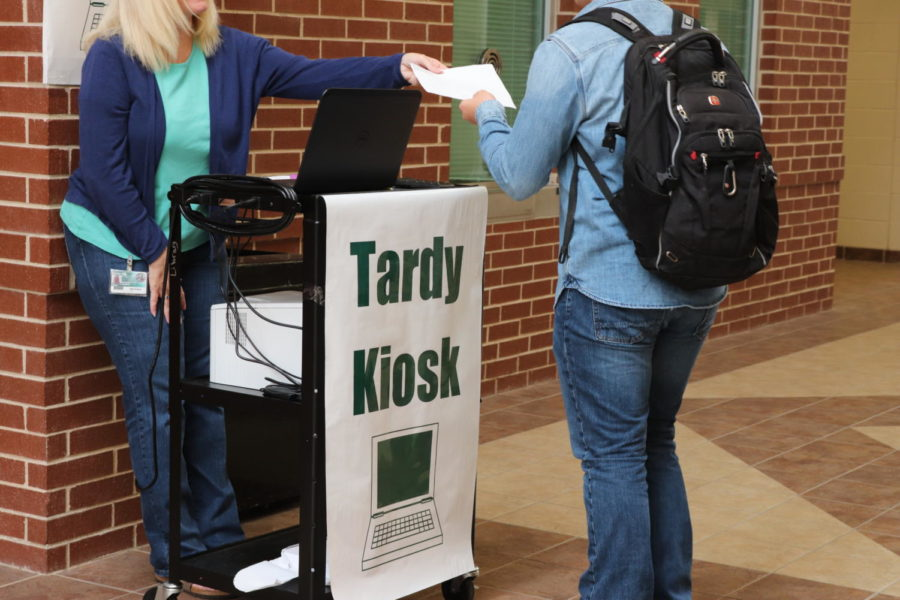 Mrs.+Hazlett+gives+an+anonymous+student+a+tardy+slip.+This+tardy+slip+is+required+to+get+into+class+once+you+are+late.+%22We+want+to+see+with+the+Tardy+Kiosk+is+getting+students+students+into+their+classes%2C%22+Assistant+Principal+Dedrick+Buckles+said.+