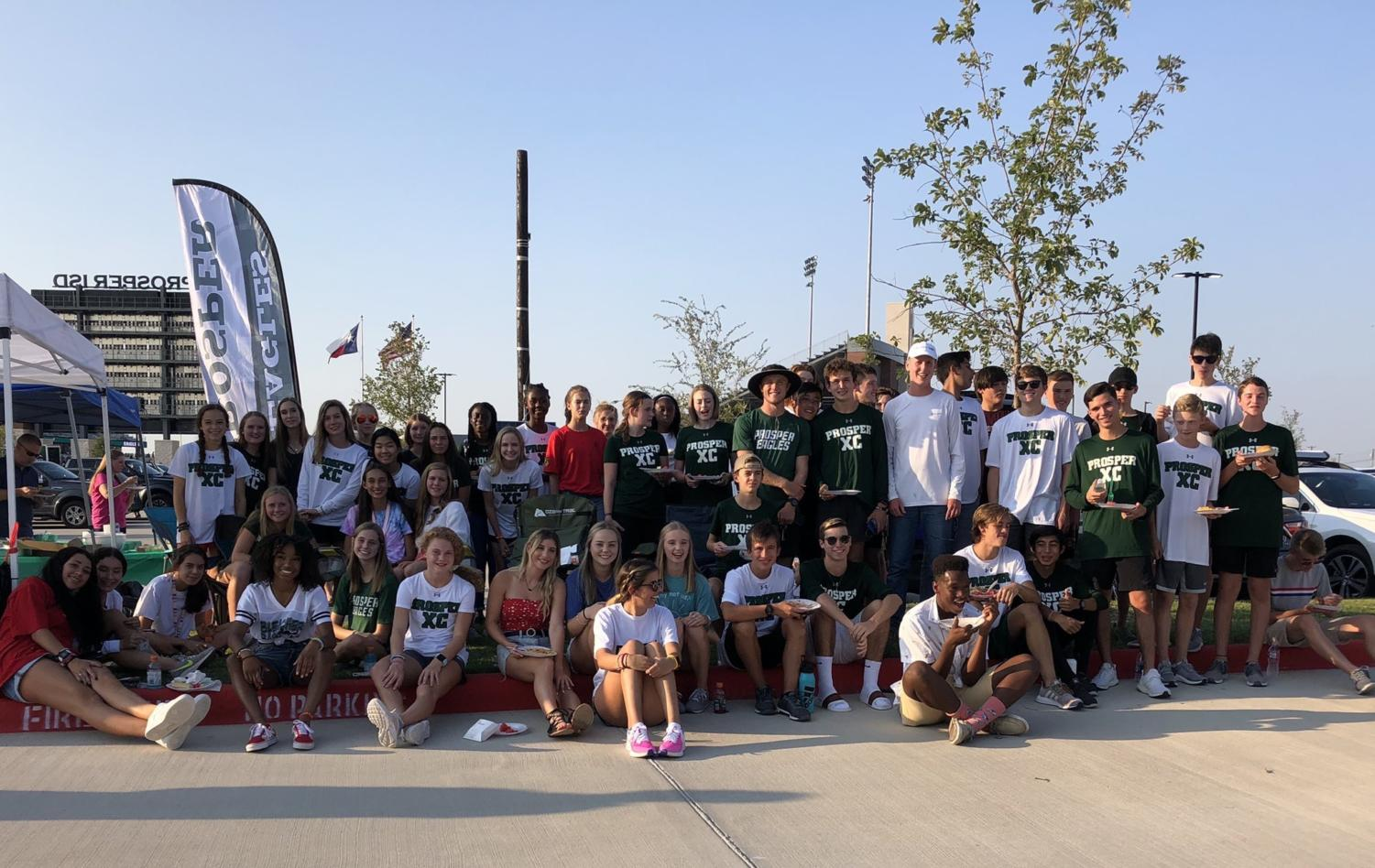 The boys and girls cross country teams sat together during a team dinner while tailgating prior to the football game against Timber Creek. Their season started in August and wraps up with a final meet in November. The runners practice every morning at 6 a.m.