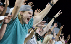 With hands lifted high, senior Hunter Sheffield does not hold back his cheers at the Eagles matchup against McKinney High Friday, Sept. 20. Although there was a light rain shower late in the third quarter, the student section broke out to sing