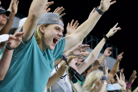 "With hands lifted high, senior Hunter Sheffield does not hold back his cheers at the Eagles matchup against McKinney High Friday, Sept. 20. Although there was a light rain shower late in the third quarter, the student section broke out to sing ""Sweet Caroline"" together. Prosper came out on top  with a win over the Lions 49-14. ""My favorite moments of Friday Night Lights are the memories,"" Sheffield said. ""I always tend to meet new people at the game and always establish a friendship, or get to know them better when it"