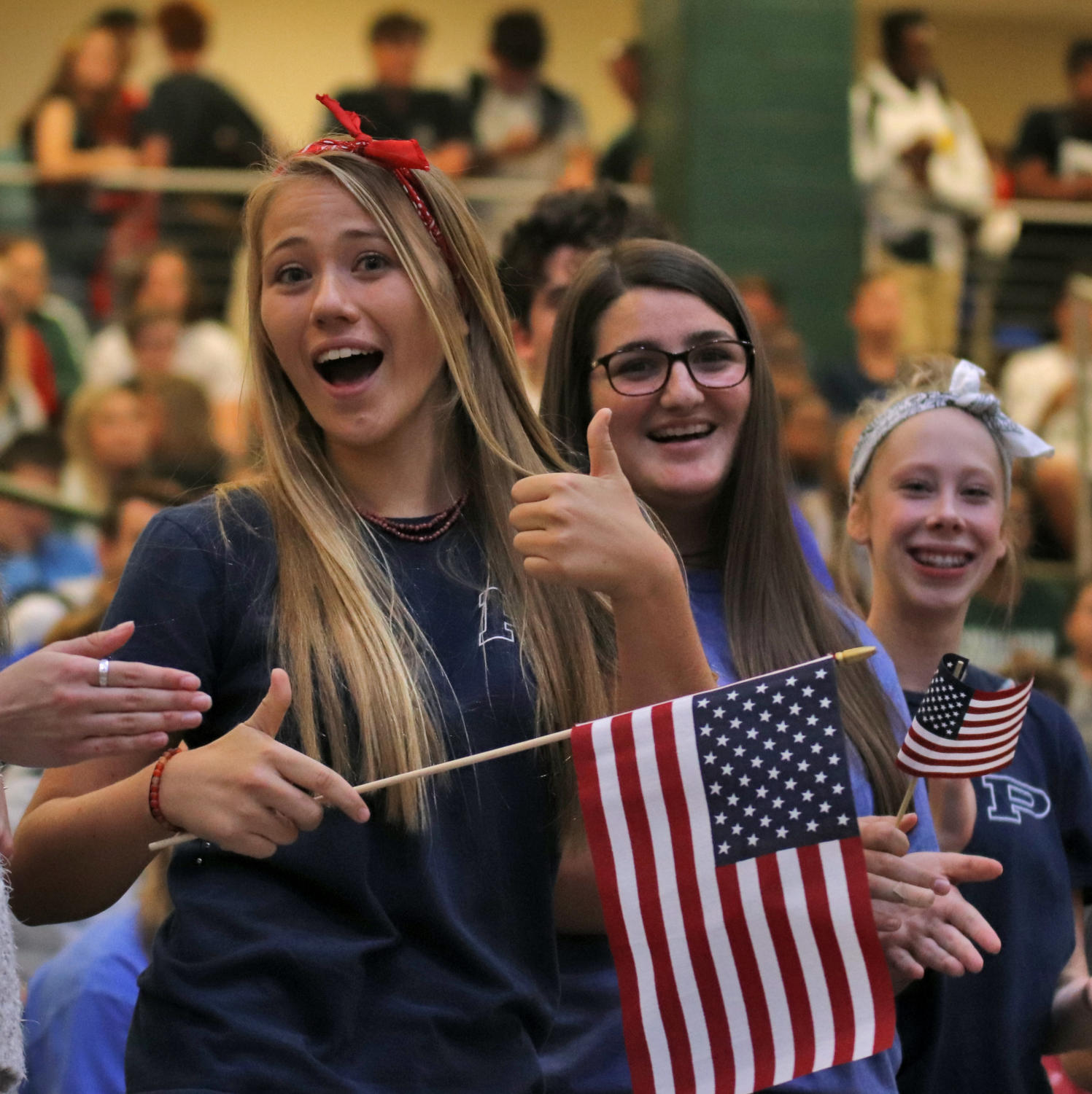 Juniors+Madi+Wells+and+Maddie+Varney+smile+for+the+camera+at+the+USA+pep+rally%2C+last+Friday%2C+Sept.+6.+Students+danced%2C+sang+and+honored+veterans+at+the+event.+The+next+pep+rally+will+include+the+community+on+Sept.+27+at+the+stadium.+