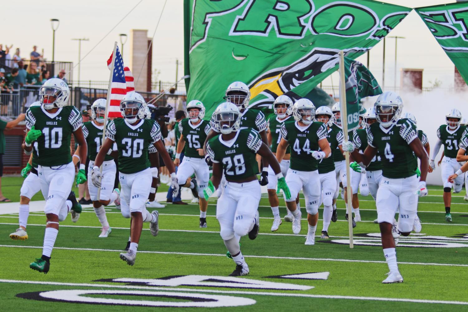 Players+break+through+the+football+banner+prior+to+kick+off.+Prosper+faced+Rowlett+in+the+home-opener.+They+came+up+with+a+win+31-7.