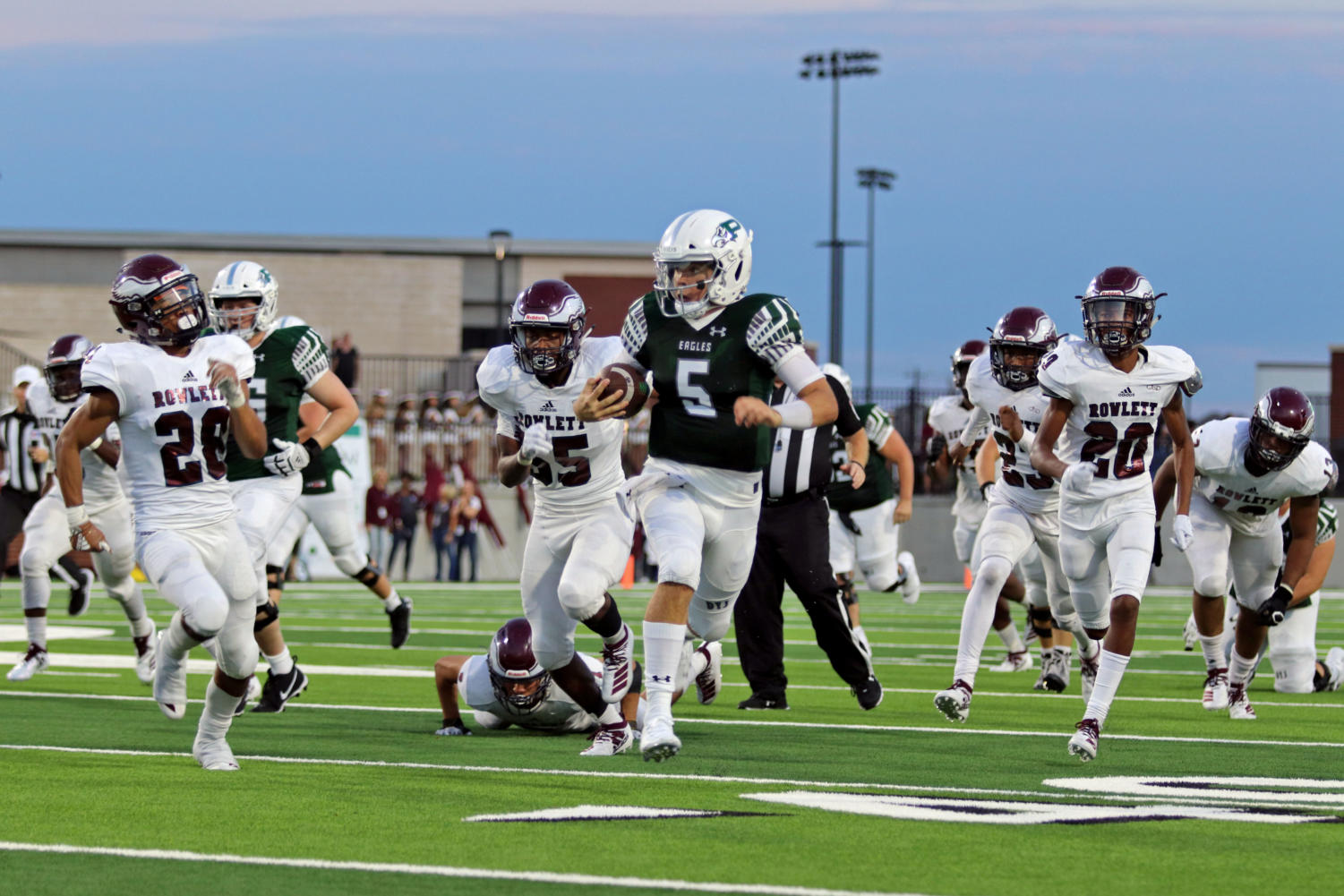 Quaterback+Jackson+Berry+pushes+through+the+tackle+and+finds+a+hole+to+run+the+ball.+He+was+ran+out+of+bounds+at+Rowlett%27s+30-yard+line.+Berry+threw+a+total+of+106+yards+to+end+the+night+and+rushed+68+more.++