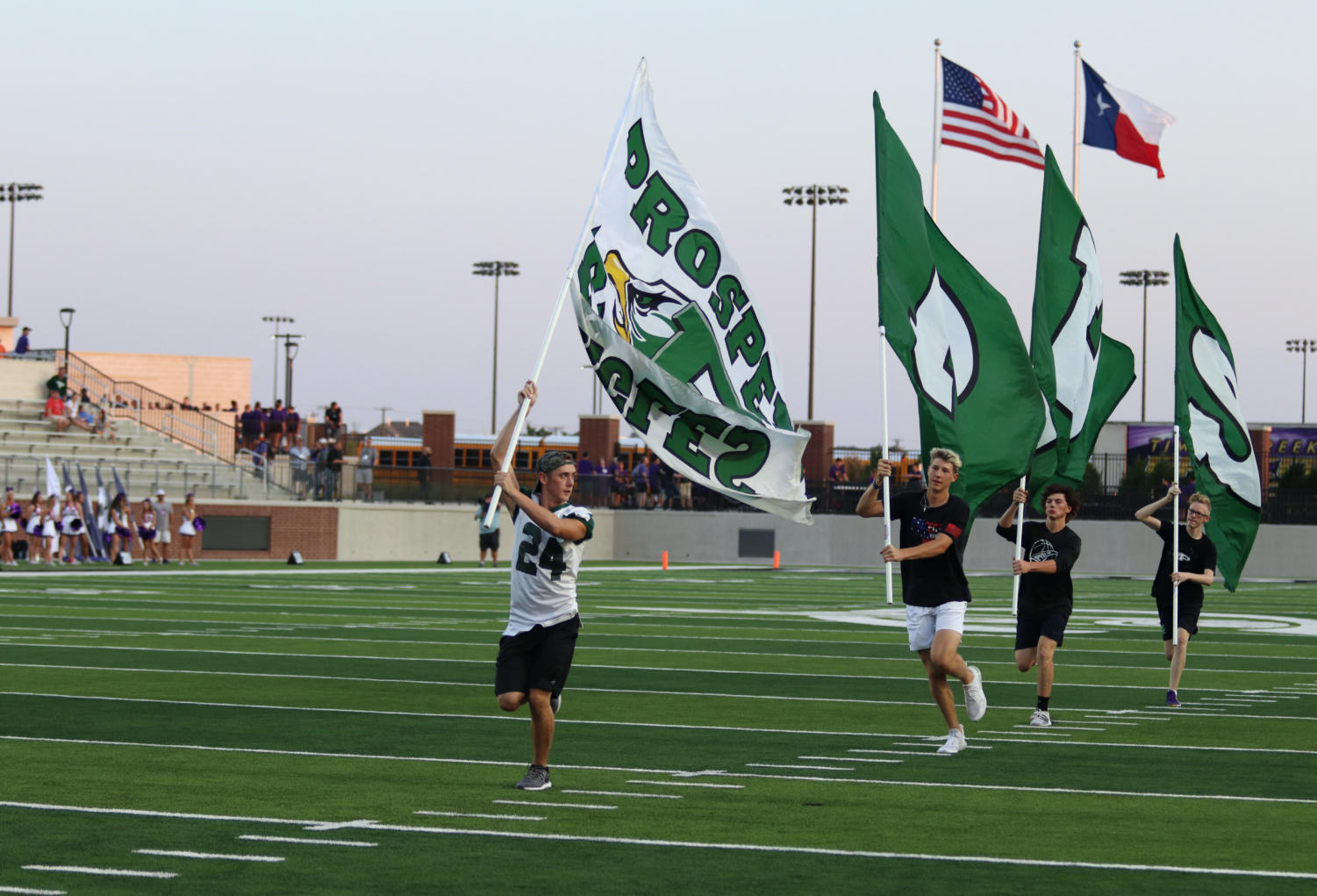 Flag+runners+run+across+the+field+with+PHS+flags+after+a+touchdown+scored+by+Tyler+Bailey%2C+No.+4.+The+boys+race+across+end+zone+to+end+zone+to+celebrate+points+put+on+the+scoreboard.+Afterwards%2C+spirit+leaders+do+as+many+push+ups+as+points+scored+alongside+superintendent+Drew+Watkins.