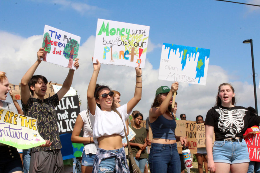 Protesters+stand+along+to+show+their+support+for+the+climate.+Hundreds+of+youth+gathered+on+the+steps+of+the+Collin+College+Courthouse+to+protest+the+pollution+of+the+environment.+%22Hey%21+Hey%21+Ho%21+Ho%21+Fossil+fuels+have+got+to+go%21%22+shouted+protesters.+
