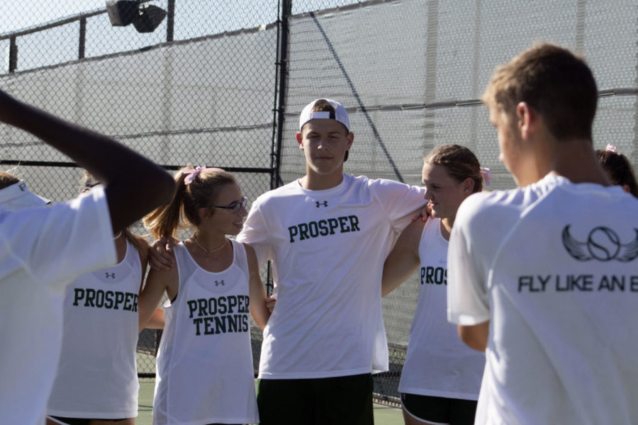 Tennis+players+Haley+Britton%2C+Zach+Schryver+and+Caroline+Wilburn+huddle+before+the+match+against+Plano+Senior+on+Friday%2C+Sept.+27.+Prosper+came+out+on+top%2C+beating+Plano+13-6.+Prosper+is+now+4-3+going+into+district+play.+