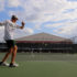Star tennis players raise racket(s) on court