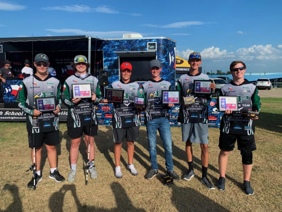 Members+of+the+bass+fishing+team+hold+up+awards+after+a+tournament.+%22The+very+first+tournament+this+year+we+got+first+place%2C%22+Luke+Bradley+said.+%22Me+and+my+buddy+Jake+%28Holmquest%29+got+first+too%2C+but+the+team+as+a+whole+brought+home+a+trophy.%22+The+bass+fishing+team+also+won+the+Ray+Roberts+tournament+this+year.