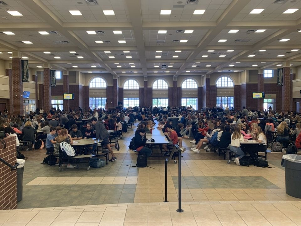 "Due to not having a specific location to go, a sea of students fill the cafeteria during Eagle Time prior to the new policies governing this period. Photojournalist Emily Reish snapped this shot on Sept. 26. ""We started figuring out and thinking 'what can we do better?'"" principal John Burdett said."