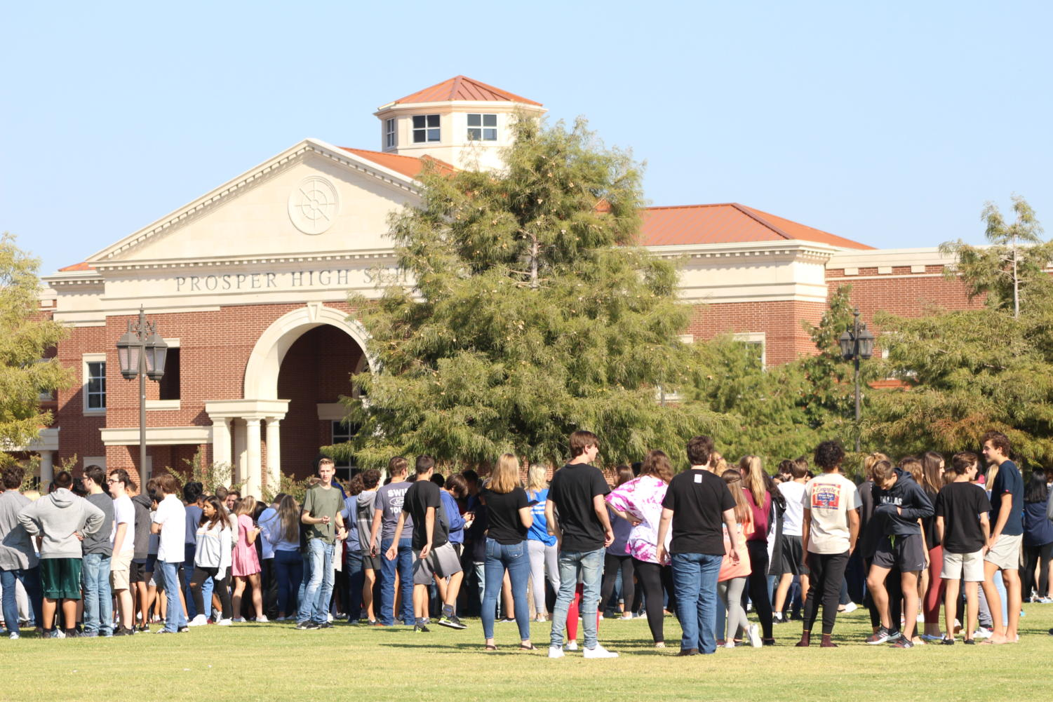 Students gather outside after the fire bells rang throughout Prosper High School at 10:23 on Thursday, Oct. 3. While the drill only lasted four minutes, it gave new students an insight into what is expected in the safety of our students.