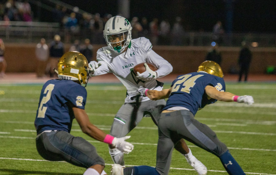 Tyler Bailey, No. 4, looks for open holes to run the ball. He scored a touchdown in the first quarter. The Eagles lost to Jesuit 41-14.