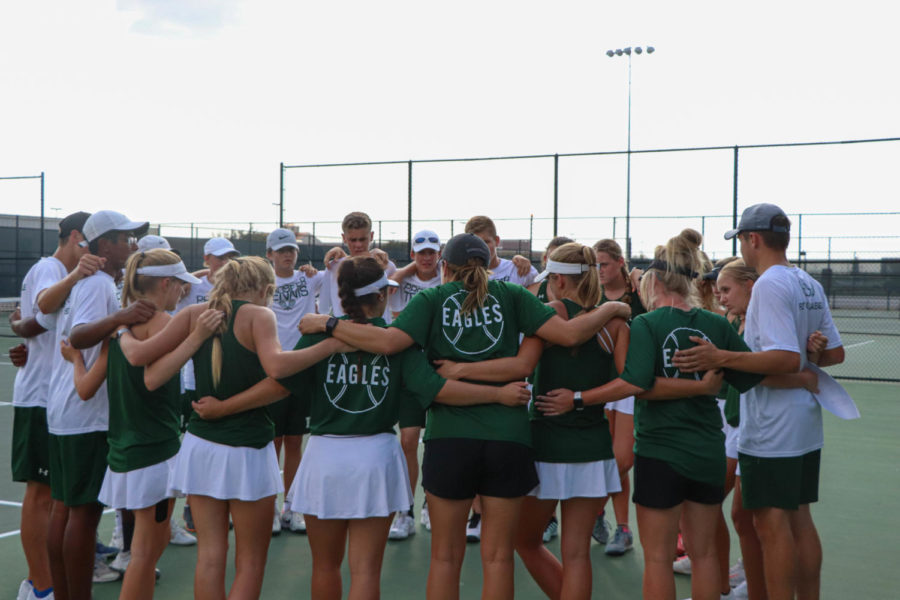 The Prosper Tennis team huddles before their match against Plano. Prosper beat Plano 10-8 to reach the next round of districts. The Eagles will take on Plano West at Plano West on Monday, Oct. 7 at 4:45 p.m.