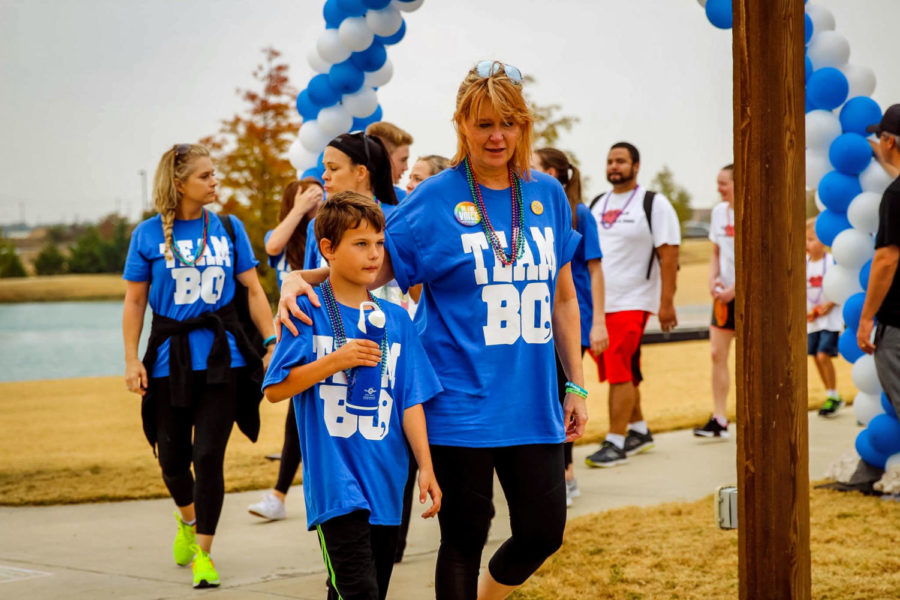 Shannon Gill holds her nephew Braxton Palasota as they continue walking during the 2018 Out of the Darkness Walk. This year will be Prosper's third year hosting one. Prosper's annual Out of the Darkness Walk will happen Nov. 2 at 8:30 a.m.
