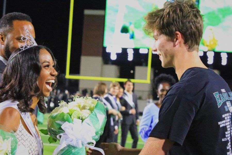 Homecoming queen Victoria Carpenter receives a bouquet of flowers from student body president Preston Cutler. Carpenter ran alongside senior Panashe Ruswayi. They were also named to the sophomore homecoming court in 2017.