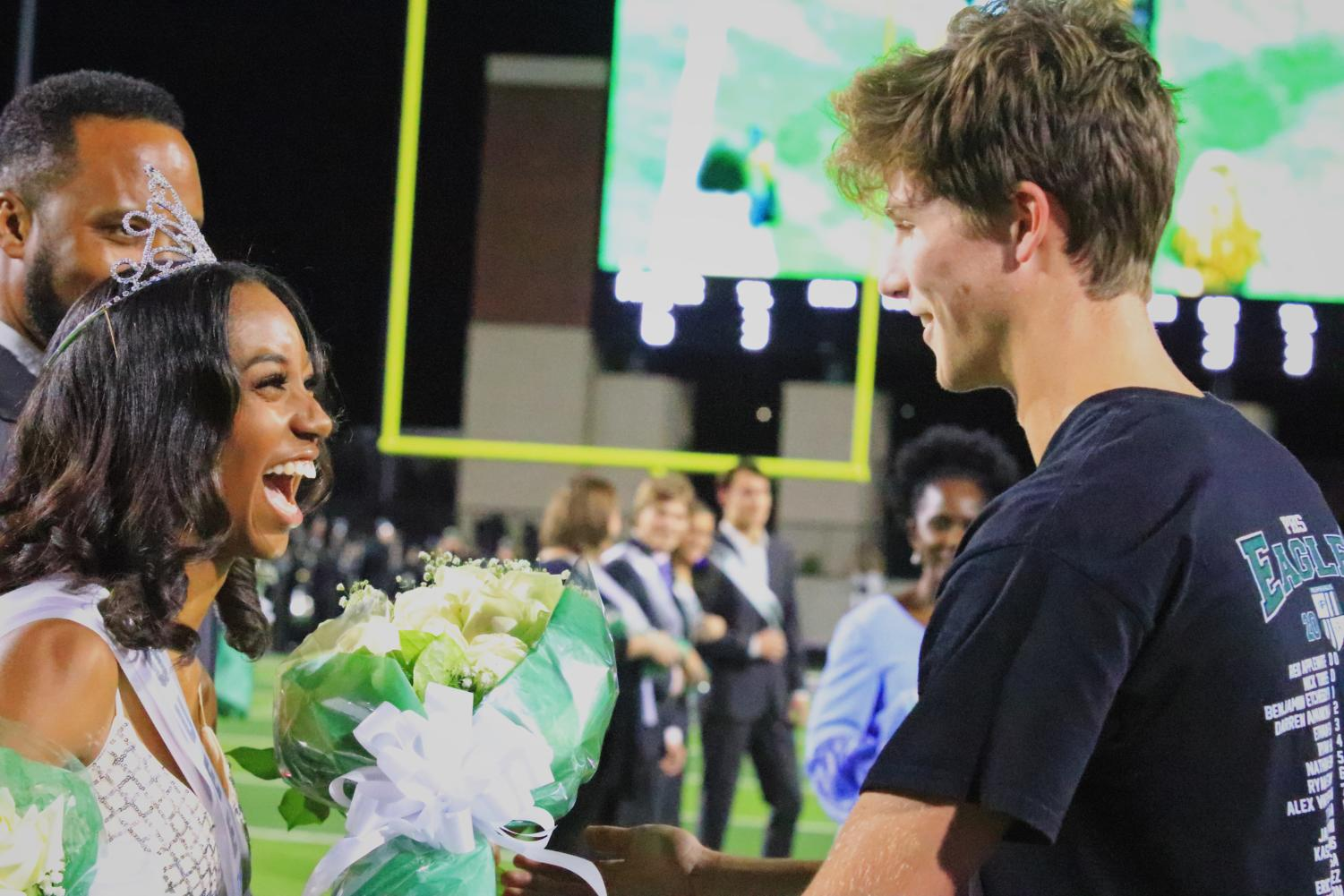 Student body president Preston Cutler hands homecoming queen Victoria Carpenter a bouquet of flowers. Carpenter ran alongside senior Panashe Ruswayi. They were also named sophomore homecoming court in 2017.