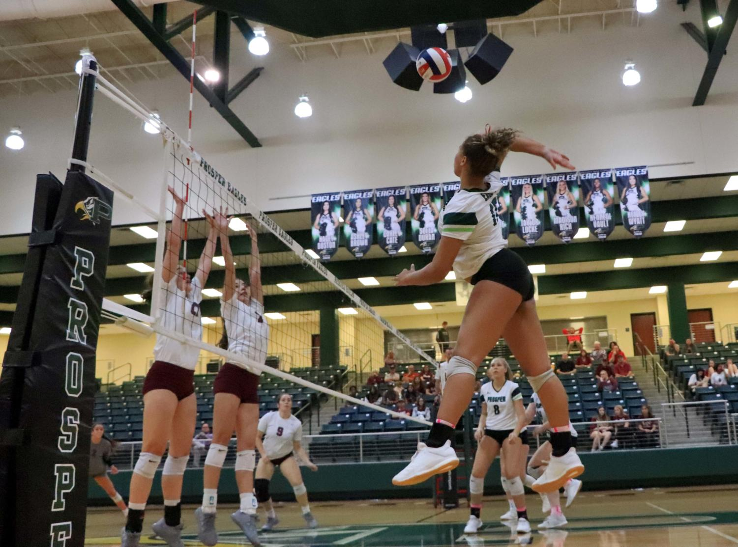 Varsity setter Mackenzie Jefferson prepares for a kill. She helped lead the team to victory on Friday, Oct. 4 at the Prosper Eagle Arena. In Friday's match against Plano Senior, Mackenzie racked up seven digs and 15 assists.