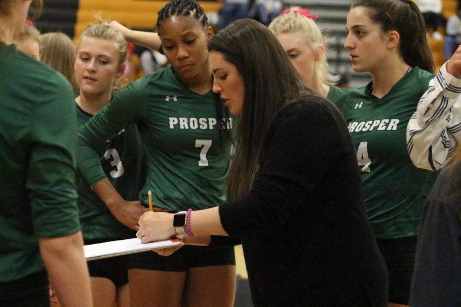 Head volleyball coach Erin Kauffman goes over plays with the team during a timeout.  Kauffman has been Prosper's head volleyball coach for seven years now and led the team to win state in 2017.