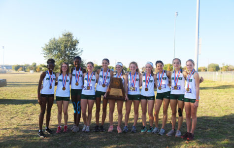 The girls cross country team displays their winnings after placing third at the UIL 6A state championship. Sophomore Aubrey O'Connell placed first, senior Tatum Castillo placed 21st and Alexis Svoboda placed 26th. O'Connell won the race and is this year's 6A State Champion.