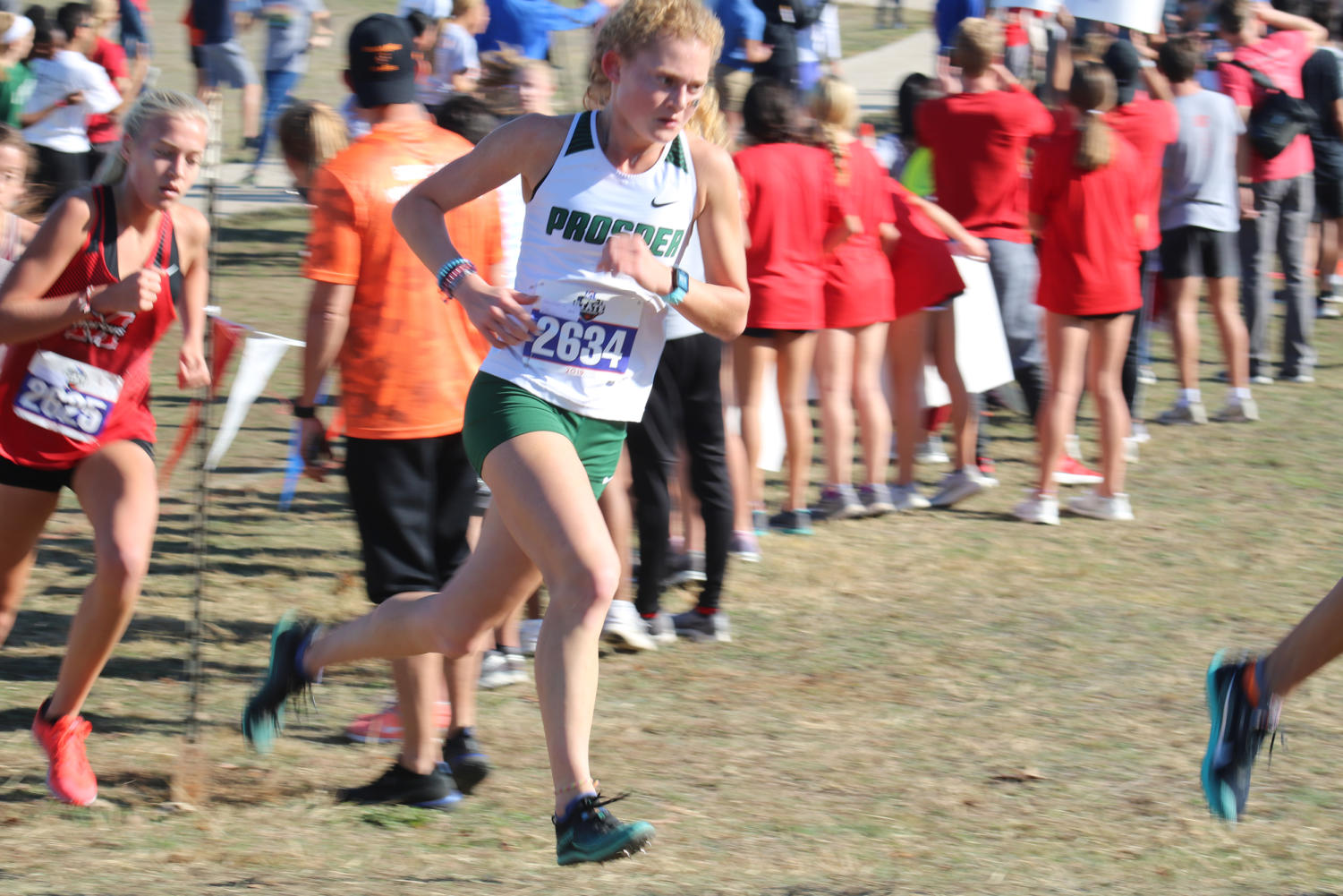 Sophomore Aubrey O'Connell races in the 5,000-meter competition. O'Connell won the state meet and was named