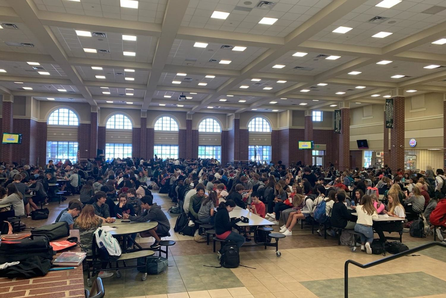 Before the draft system, the cafeteria faced overcrowding as pictured above on September 26. With the draft, more students stay in classrooms.