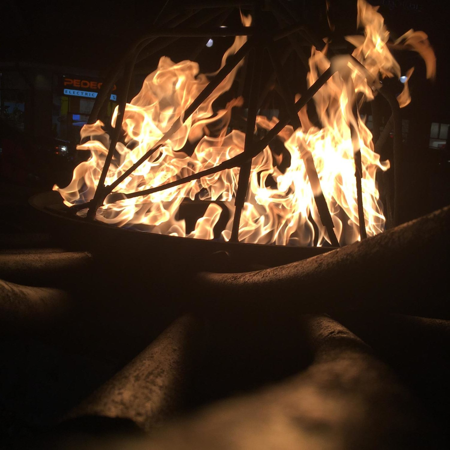 A fire pit burns at Southlands Mall in Aurora, Colorado. Column author, Rin Jackson, took this photo years ago when she lived near there.  Flames are a symbol for Complex Regional Pain Syndrome, as burning alive is considered a comparable pain.