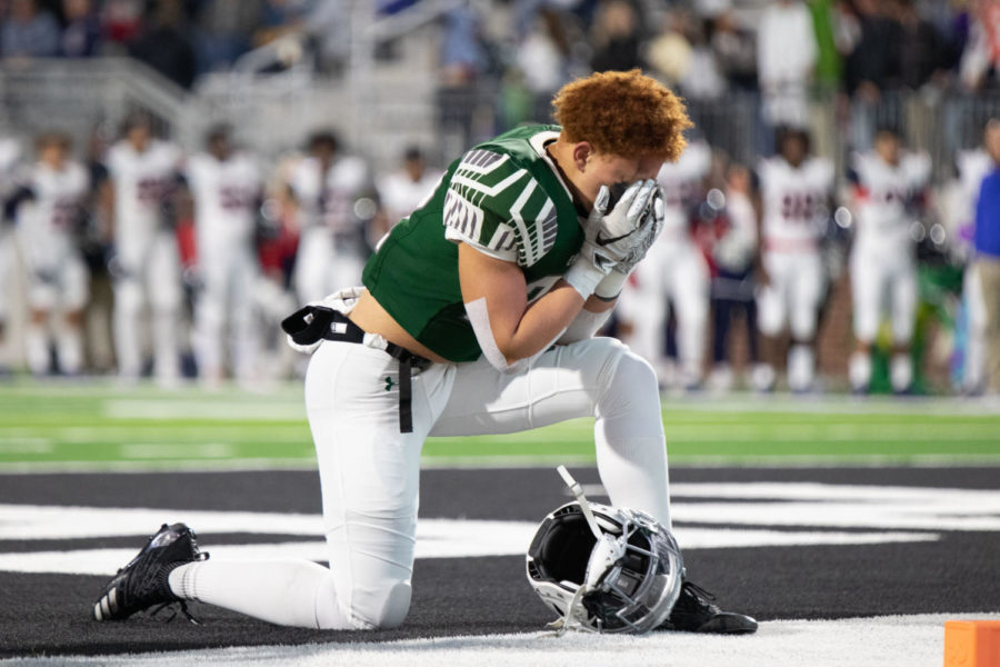 Junior Herman Lee kneels at the goal post before kick off. Prosper fell to Allen 35-7. The Eagles look to play Plano on Friday. The seniors will be honored before the game.