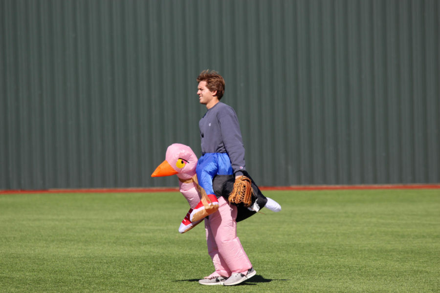 Senior+Cade+Ferguson%2C+dressed+as+an+ostrich+rider%2C+plays+in+left+field.+This+was+his+final+year+participating+in+the+Halloween+scrimmage.+%22The+costume+just+appealed+to+me%2C%22+Ferguson+said.+%22I+thought+it%27d+look+goofy+running.%22+