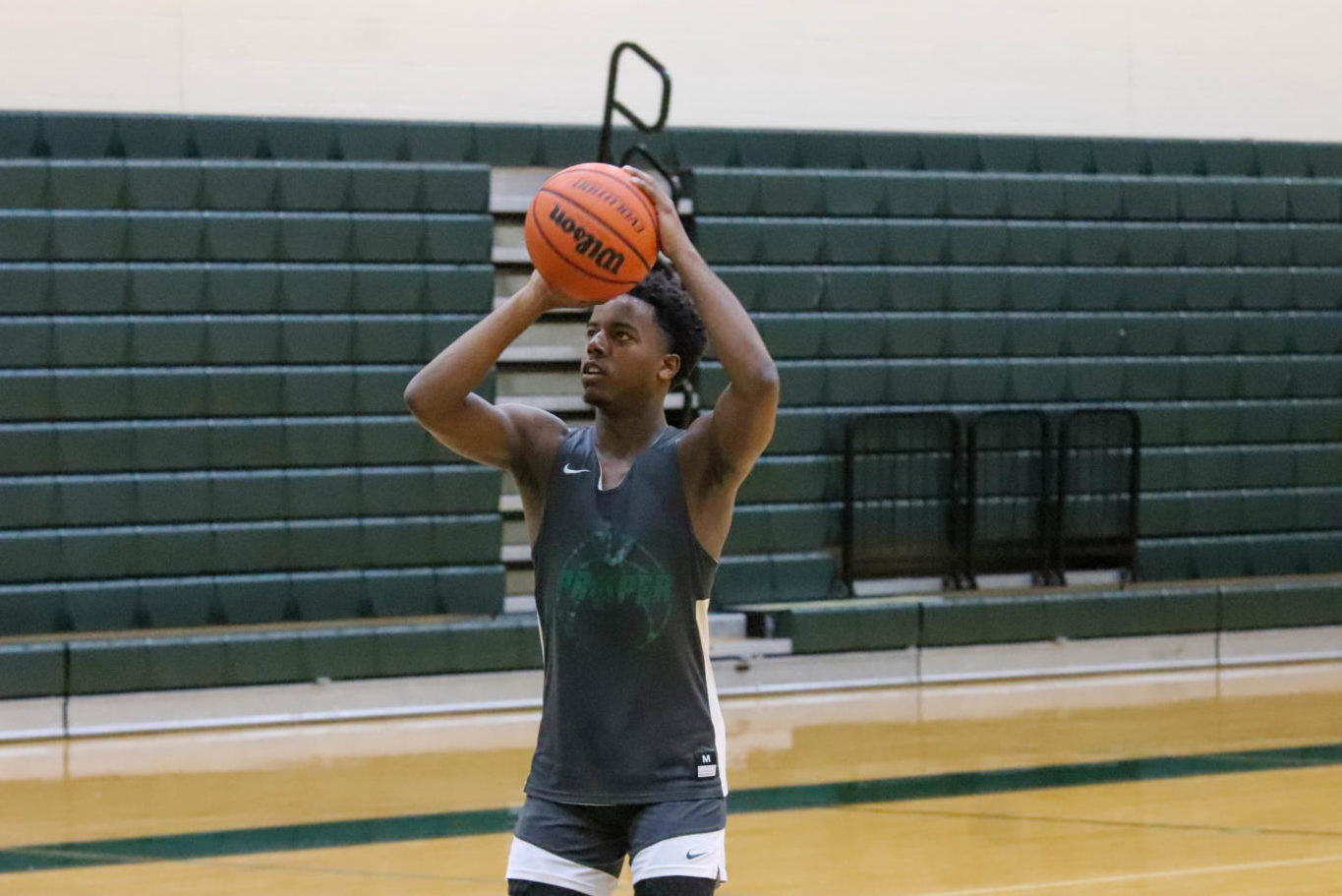 """Junior Grant Shaw shoots the ball during a morning practice. Shaw was an honorable mention all-district player last year. """"We have good potential to go far this year,"""" varsity manager and junior Boston Bogard said. """"We have a lot of talent and our team is prone to do something good."""""""