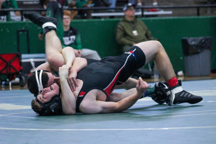 L.J.+Richardson+puts+his+opponent+in+a+cradle+to+get+a+pin+at+Saturday%27s+tournament.+Prosper%27s+varsity+boys+wrestling+team+won+first+place+at+the+Arlington+Invitational+on+Saturday.+%22The+team+did+really+well+on+Saturday%2C%22+Richardson+said.+%22But%2C+we+are+always+looking+to+improve+as+a+team+and+as+individuals.%22%0A