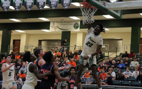 Senior Mondo Battle,  No. 22, dunks on the opposing McKinney North Bulldogs. Battle scored 20 points throughout the game with multiple dunks and three-pointers. The Eagles play W.T. White on Saturday, Nov. 23 at home.