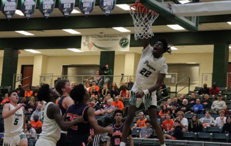 Varsity basketball 'dunks on' Mckinney North in 1st game of season