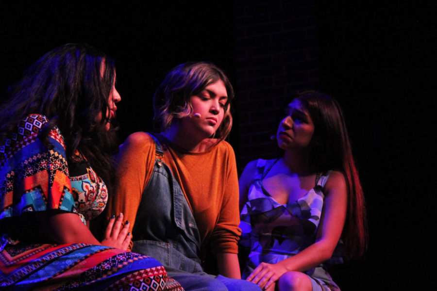 Freshman Alex Thomas and senior Zoe Castaneda comfort senior Tori England during the song Chiquitita. The three play Rosie, Tanya, and Donna respectively. The cast and crew has performed three times already, with just two shows left on Nov. 8 and 9.