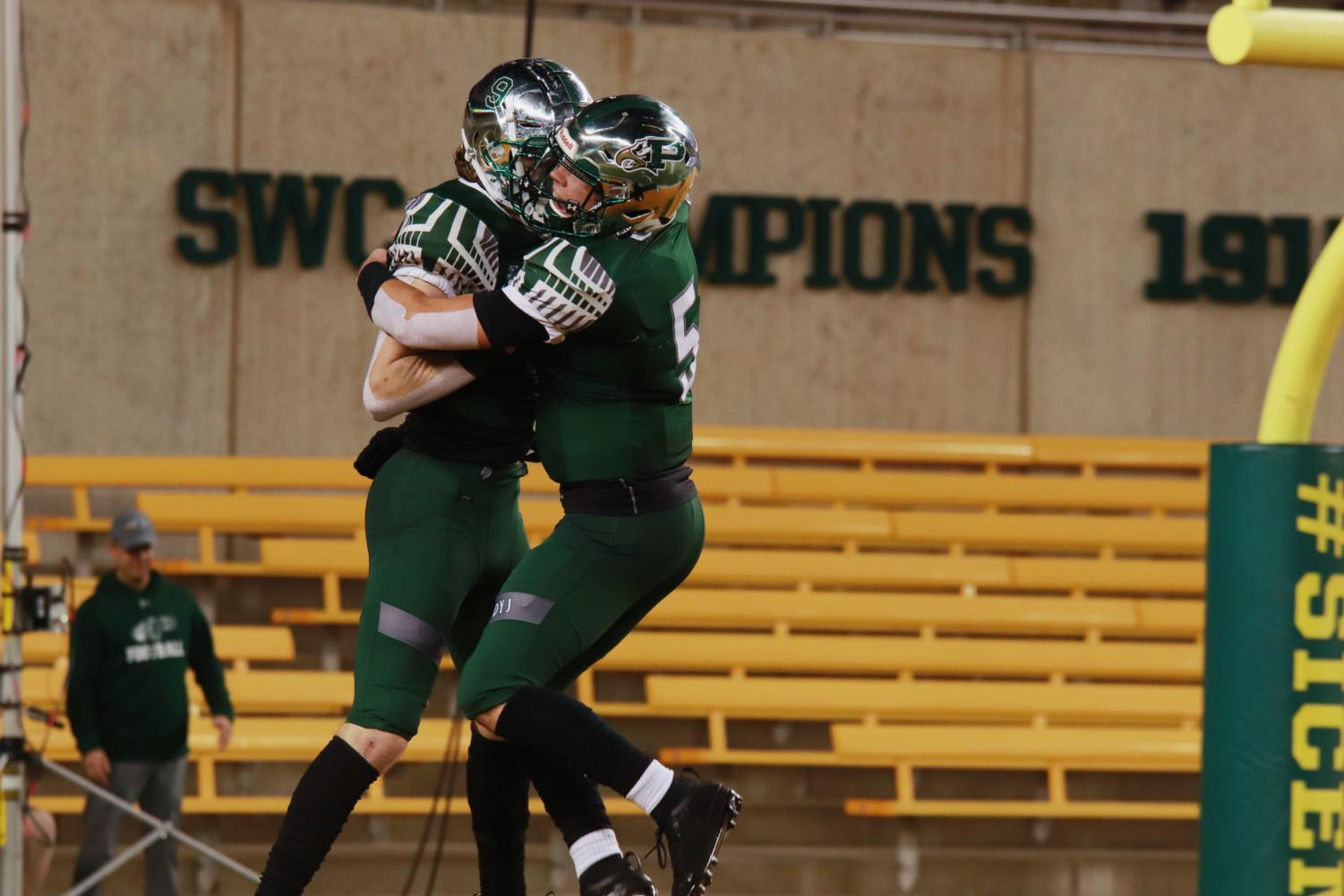 Quarterback Jackson Berry, No. 5, and receiver Cameron Harpole, No. 9, celebrate a 46-yard pass touchdown.