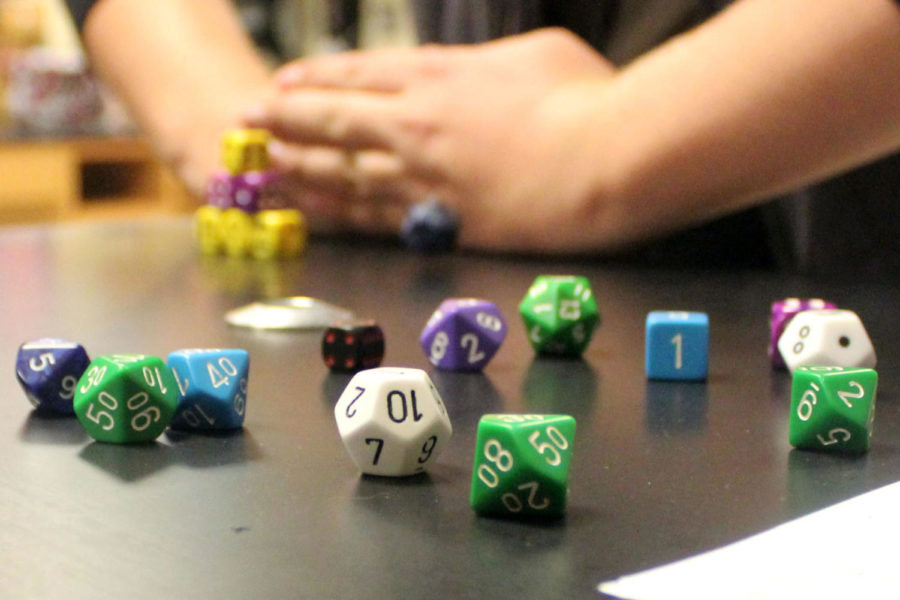 Dice+sit+on+a+table+while+members+play+a+game+of+Dungeons+and+Dragons.+%22If+you+like+games+where+you+can+escape+your+day+to+day+and+just+have+a+good+time%2C+you+can+come+and+join%2C%22+said+club+member+Ryan+Aaron.+The+club%2C+started+last+year%2C+has+over+50+members+that+meet+weekly.+If+you+are+interested+in+joining+contact+club+sponsor%2C+Ms.+Robison.