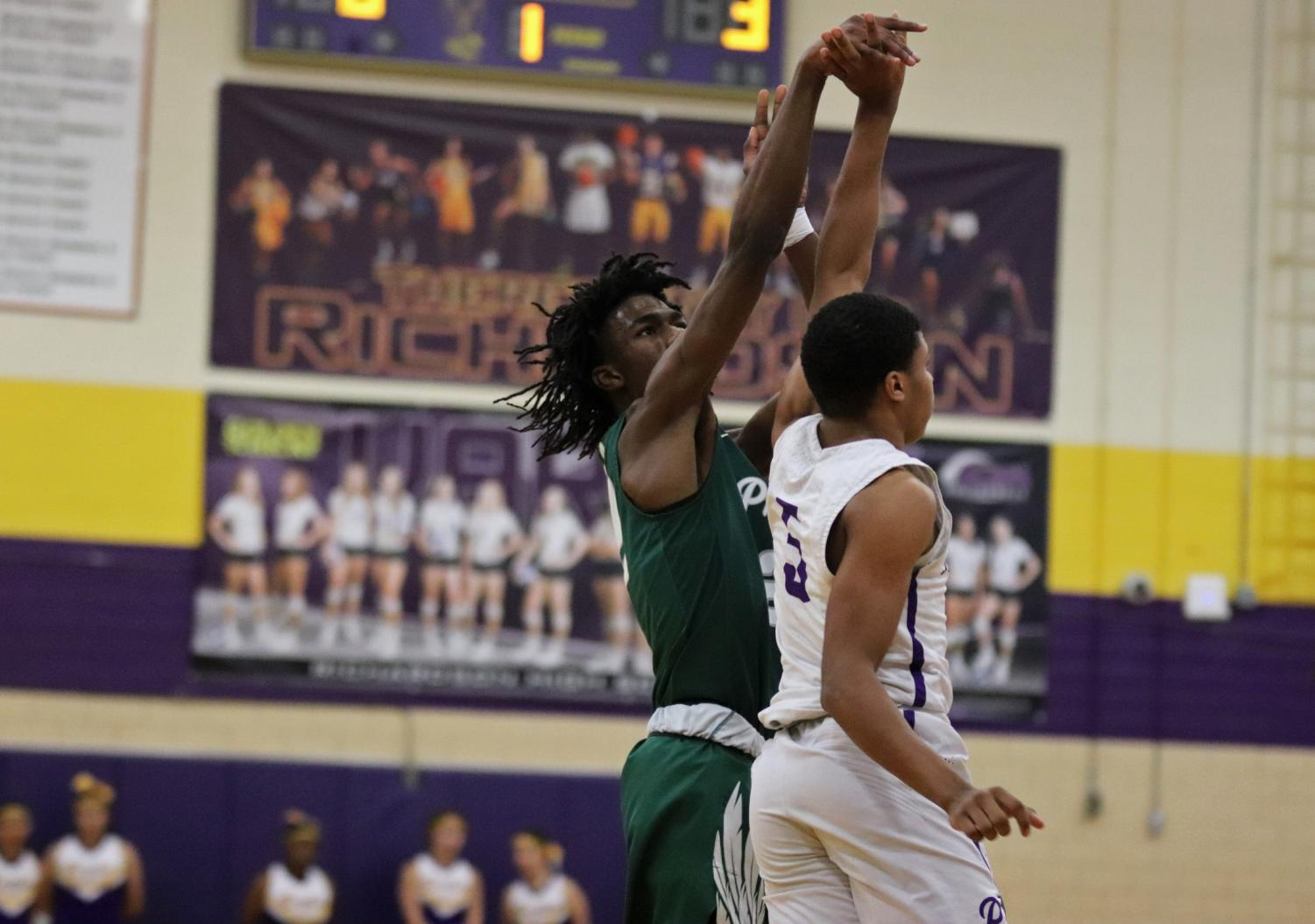 Senior Mondo Battle, No. 22, shoots the ball while a Richardson player attempts to block it. He put up several threes throughout the game. Battle will return Tuesday night against The Colony.