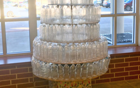 A plastic water bottle Christmas tree made by the student council stands on the stage in the cafeteria. The editorial board writes about the lack of responsibilities given to student council.