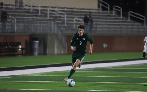Senior captain Jack Simonini leads the ball downfield. The Eagles are went 4-3-1 in pre-season. They kickoff district play against McKinney High Tuesday, Jan. 21 at 7:30 p.m.