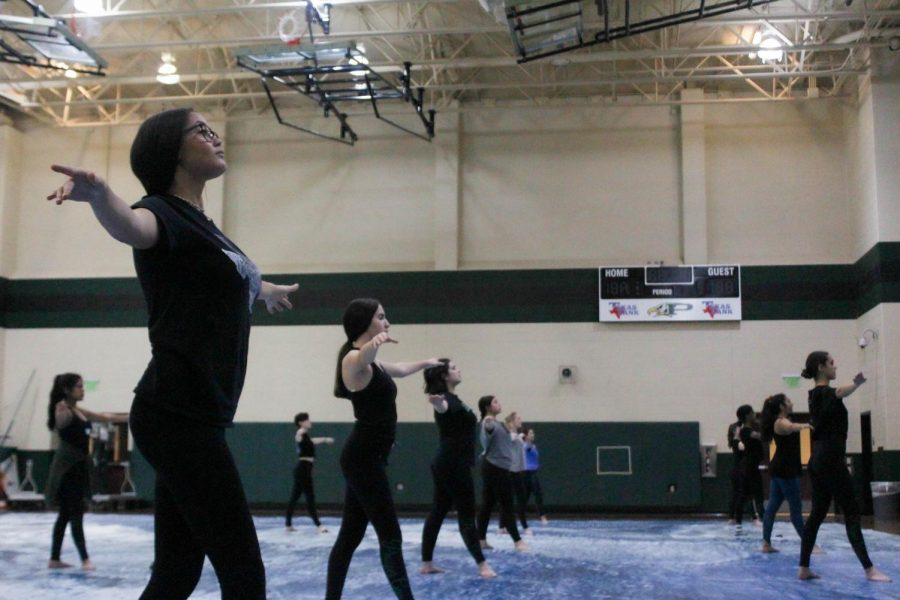 The+Winter+Guard+improves+their+lower+body+technique+for+their+upcoming+competition.+They+will+compete+at+Coppell+High+School+on+Feb.+8.+Their+show%2C+%22River%2C%22+begins+at+9%3A40+a.m.